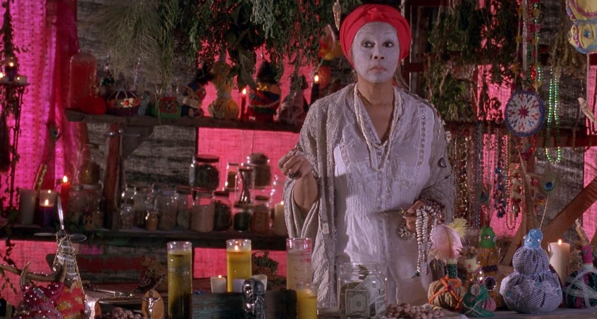 A character stands in a colorful room wearing face cream in Eve's Bayou