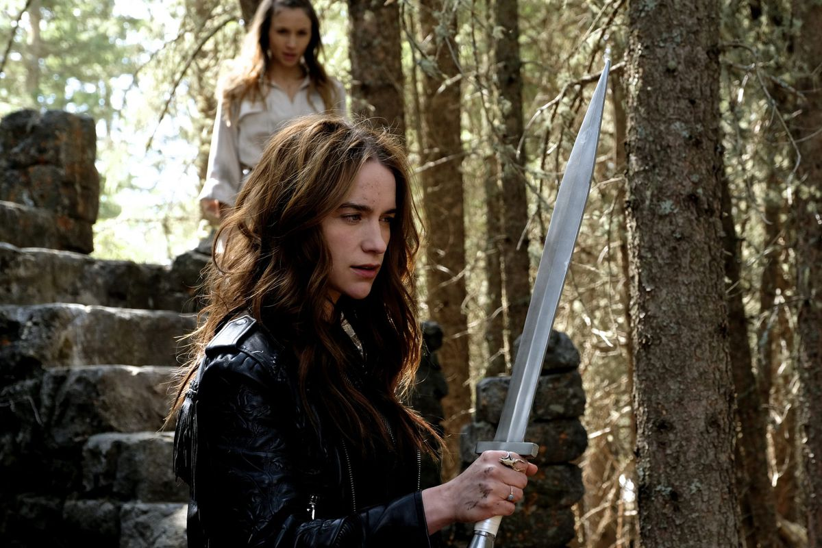 wynonna earp holding a silver sword in a forest