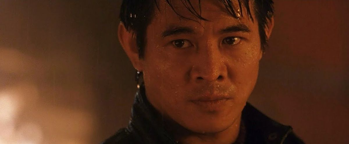 Jet Li staring down his opponent in a ring of fire