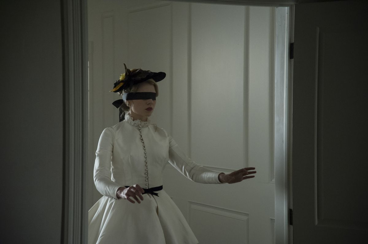 I am the Pretty Thing that Lives in the House - blindfolded woman in white dress walking through a door