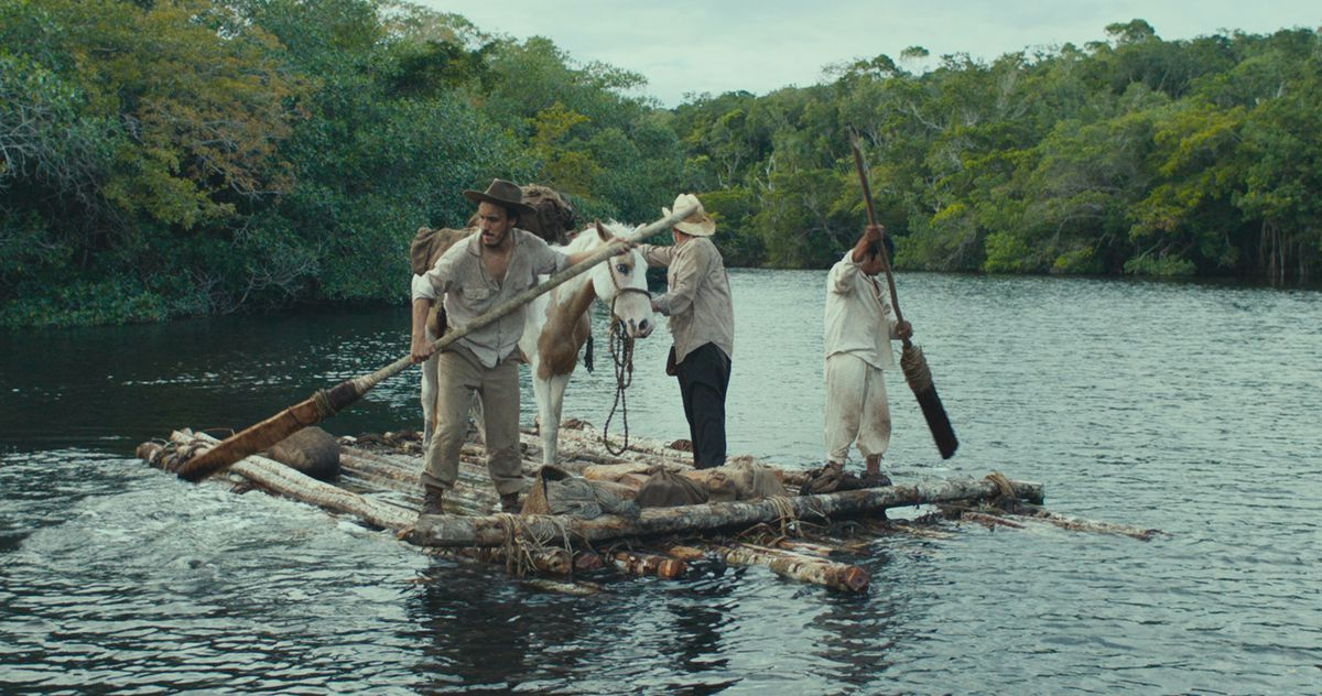 Three men and a pack horse on a raft in a river, mid-jungle, in Tragic Jungle