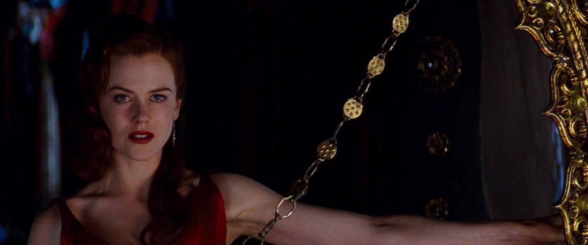Nicole Kidman grimly sings out her escape fantasies in Moulin Rouge
