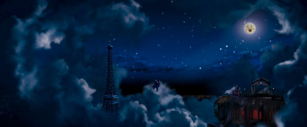 Ewan McGregor and Nicole Kidman dance in the sky in an enchanted Paris while the moon sings overhead in Moulin Rouge