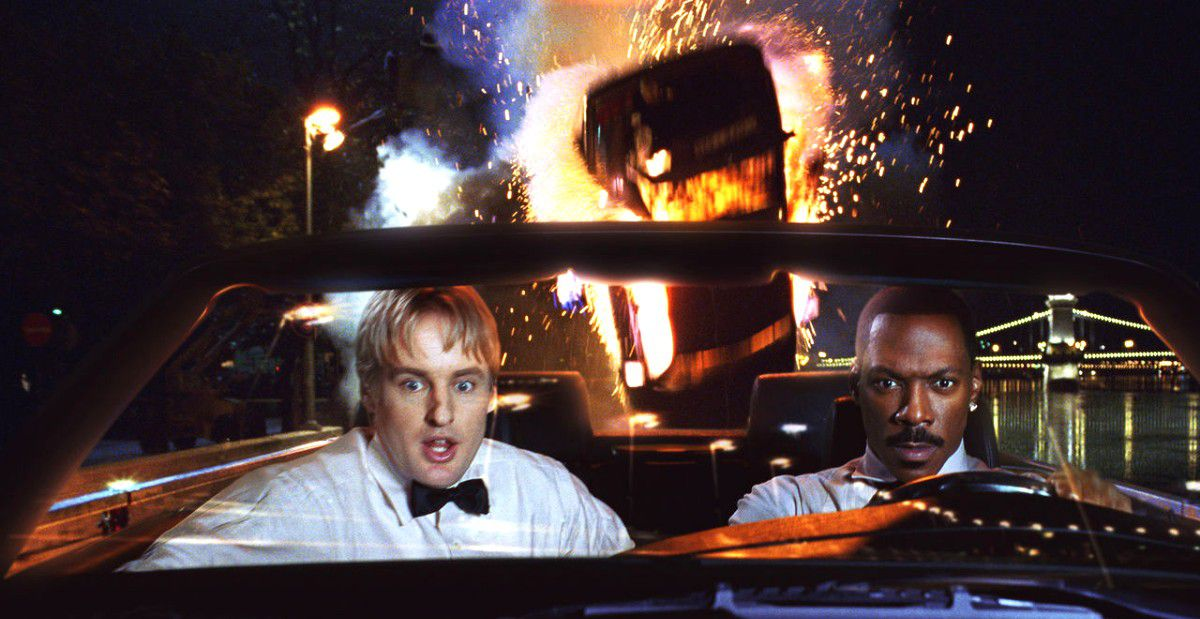 Owen Wilson and Eddie Murphy drive away from an explosion in 2002's I Spy