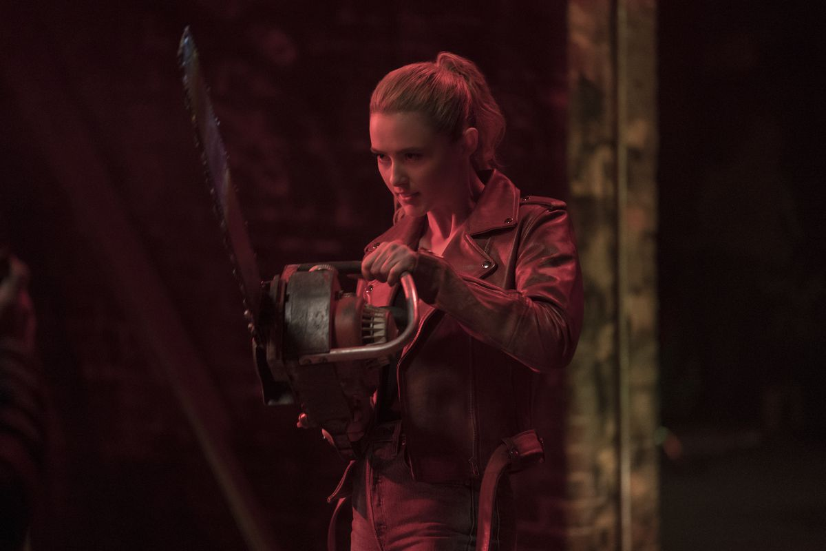 Lit entirely in red, Freaky star Kathryn Newton brandishes a chainsaw