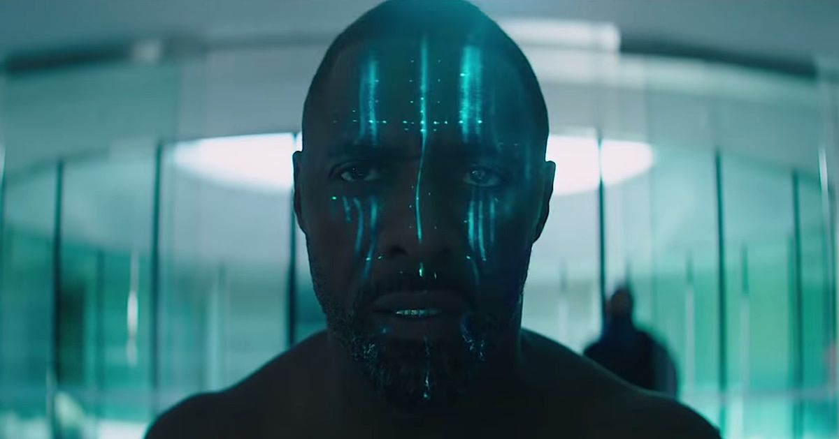 Idris Elba in Hobbs & Shaw, shirtless and with blue electronic lights up and down his face